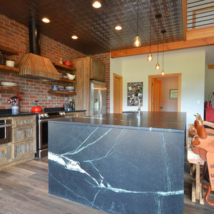 Large rustic kitchen designs - Kitchen - large rustic single-wall vinyl floor and brown floor kitchen idea in Other with open cabinets, medium tone wood cabinets, soapstone countertops, an island, a farmhouse sink, red backsplash, brick backsplash and stainless steel appliances