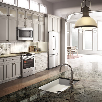 Example of a transitional kitchen design in Miami with an undermount sink and stainless steel appliances