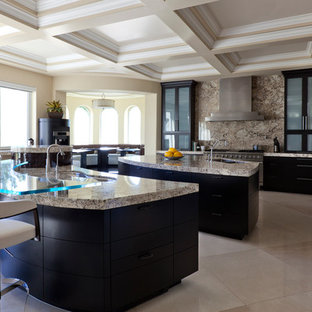 This is an example of an expansive contemporary single-wall eat-in kitchen in Phoenix with an undermount sink, flat-panel cabinets, black cabinets, granite benchtops, brown splashback, stone slab splashback, stainless steel appliances, marble floors, multiple islands, beige floor and brown benchtop.
