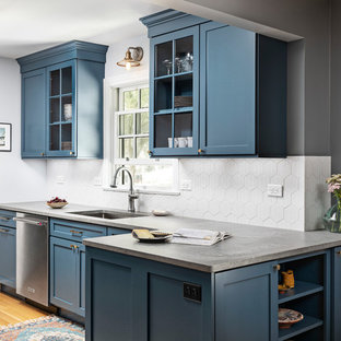Inspiration for a small beach style galley eat-in kitchen in Detroit with an undermount sink, shaker cabinets, blue cabinets, quartz benchtops, grey splashback, porcelain splashback, stainless steel appliances, light hardwood floors, no island, brown floor and grey benchtop.