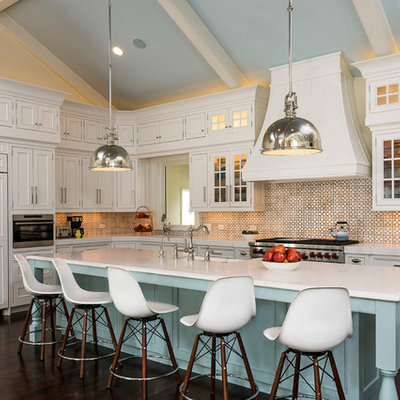 Example of a country l-shaped dark wood floor eat-in kitchen design in Chicago with beaded inset cabinets, white cabinets, multicolored backsplash, an island, marble countertops, a farmhouse sink, ceramic backsplash and paneled appliances
