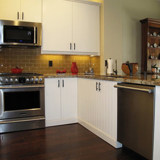 Mid-sized transitional enclosed kitchen remodeling - Inspiration for a mid-sized transitional u-shaped dark wood floor enclosed kitchen remodel in Denver with a double-bowl sink, white cabinets, yellow backsplash, stainless steel appliances and no island