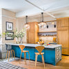 A Large Peninsula Brings Loads of Function to a Loft Kitchen