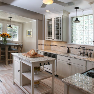Transitional l-shaped enclosed kitchen photo in Columbus with an undermount sink, recessed-panel cabinets, white cabinets, granite countertops, beige backsplash, stone tile backsplash and white appliances