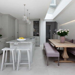 Inspiration for a large classic kitchen/diner in London with a single-bowl sink, marble worktops, white splashback, an island, white floors and grey worktops.