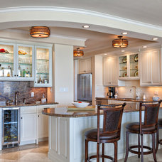 Transitional Kitchen by Palm City Millwork, Inc