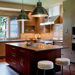 Example of a transitional kitchen design in Nashville with flat-panel cabinets, medium tone wood cabinets, multicolored backsplash and stainless steel appliances