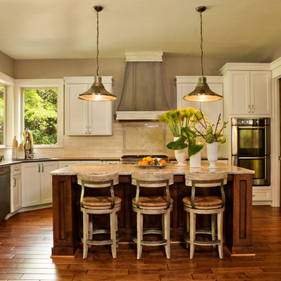 Example of a transitional kitchen design in Portland with stainless steel appliances, subway tile backsplash and quartz countertops