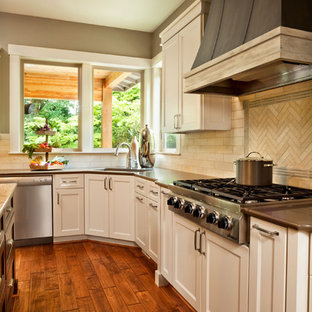 Transitional kitchen photo in Portland with stainless steel appliances and quartz countertops