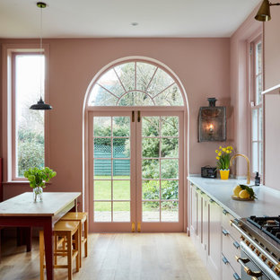 Design ideas for a medium sized classic single-wall kitchen/diner in London with a submerged sink, shaker cabinets, pink splashback, glass sheet splashback, no island, beige floors and grey worktops.