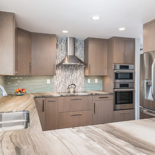 Design ideas for a small transitional u-shaped open plan kitchen in San Francisco with a double-bowl sink, flat-panel cabinets, grey cabinets, marble benchtops, blue splashback, glass tile splashback, stainless steel appliances, ceramic floors and a peninsula.