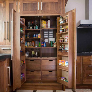 Photo of a traditional kitchen pantry in Essex with shaker cabinets and medium wood cabinets.