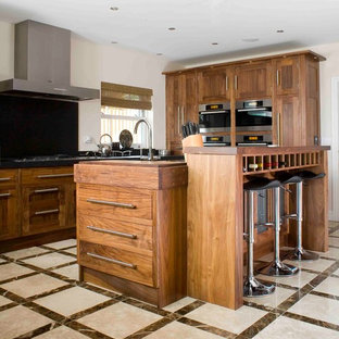 Inspiration for a transitional kitchen remodel in Essex with shaker cabinets, medium tone wood cabinets and black backsplash