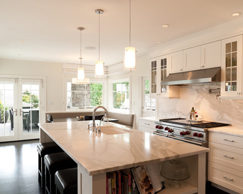 Example Of A Transitional Dark Wood Floor Eat In Kitchen Design In Seattle  With Shaker