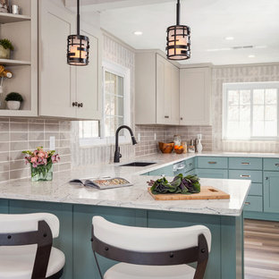 Transitional enclosed kitchen ideas - Inspiration for a transitional u-shaped medium tone wood floor and brown floor enclosed kitchen remodel in Other with an undermount sink, shaker cabinets, turquoise cabinets, gray backsplash, stainless steel appliances, a peninsula, white countertops, quartzite countertops and porcelain backsplash