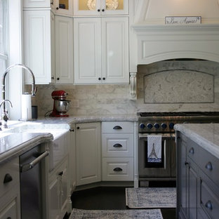 Large traditional enclosed kitchen appliance - Inspiration for a large timeless l-shaped dark wood floor and brown floor enclosed kitchen remodel in Seattle with a farmhouse sink, raised-panel cabinets, white cabinets, granite countertops, stainless steel appliances, an island, red backsplash and marble backsplash