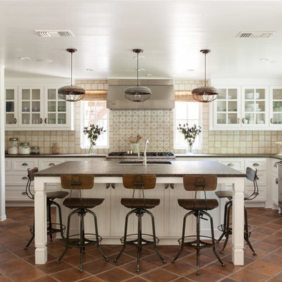Transitional u-shaped kitchen photo in Dallas with recessed-panel cabinets, white cabinets, beige backsplash and stainless steel appliances