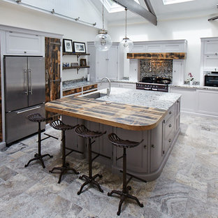 Mid-sized transitional kitchen ideas - Mid-sized transitional l-shaped multicolored floor kitchen photo in Other with an undermount sink, gray cabinets, granite countertops, stainless steel appliances, an island, recessed-panel cabinets, multicolored backsplash, stone slab backsplash and multicolored countertops