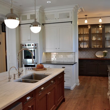 Transitional Kitchen with White Cabinets and Black Countertops