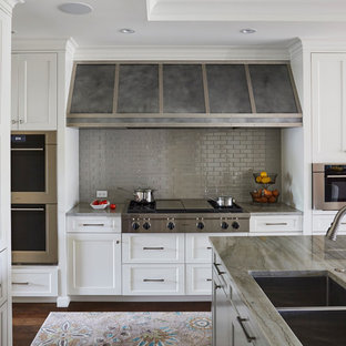 Mid-sized transitional open concept kitchen ideas - Mid-sized transitional u-shaped dark wood floor and brown floor open concept kitchen photo in Chicago with an undermount sink, shaker cabinets, white cabinets, gray backsplash, stainless steel appliances, an island, marble countertops, ceramic backsplash and beige countertops