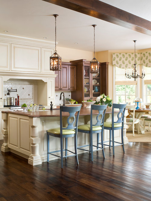 Inspiration For A Transitional Kitchen Remodel In Denver With Raised Panel  Cabinets And Beige Cabinets