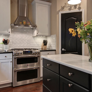Traditional eat-in kitchen inspiration - Inspiration for a timeless u-shaped eat-in kitchen remodel in Austin with a farmhouse sink, flat-panel cabinets, white cabinets, quartz countertops, white backsplash, subway tile backsplash and stainless steel appliances