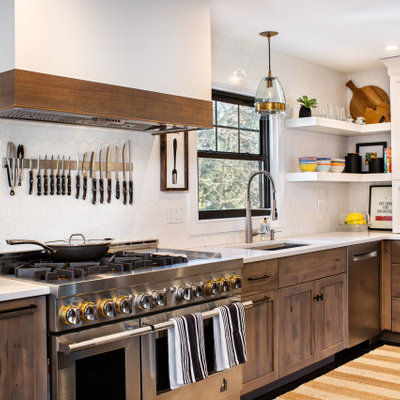 Inspiration for a mid-sized transitional l-shaped ceramic tile and black floor open concept kitchen remodel in New York with an undermount sink, shaker cabinets, medium tone wood cabinets, quartz countertops, white backsplash, ceramic backsplash, stainless steel appliances, an island and white countertops