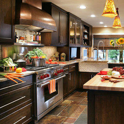 Mid-sized transitional slate floor eat-in kitchen photo in New York with a farmhouse sink, shaker cabinets, dark wood cabinets and granite countertops