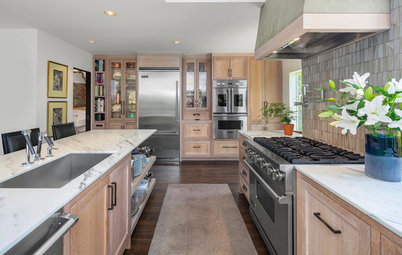 Oak Cabinets and a Stucco Hood Add Texture to This View Kitchen
