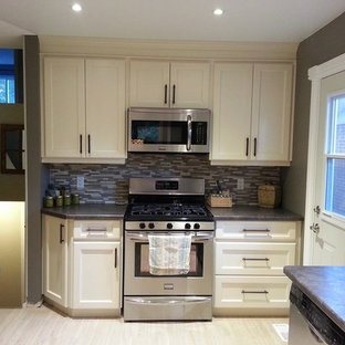 Small craftsman enclosed kitchen designs - Example of a small arts and crafts galley porcelain floor enclosed kitchen design in Toronto with a double-bowl sink, shaker cabinets, white cabinets, laminate countertops, multicolored backsplash, glass sheet backsplash, stainless steel appliances and no island