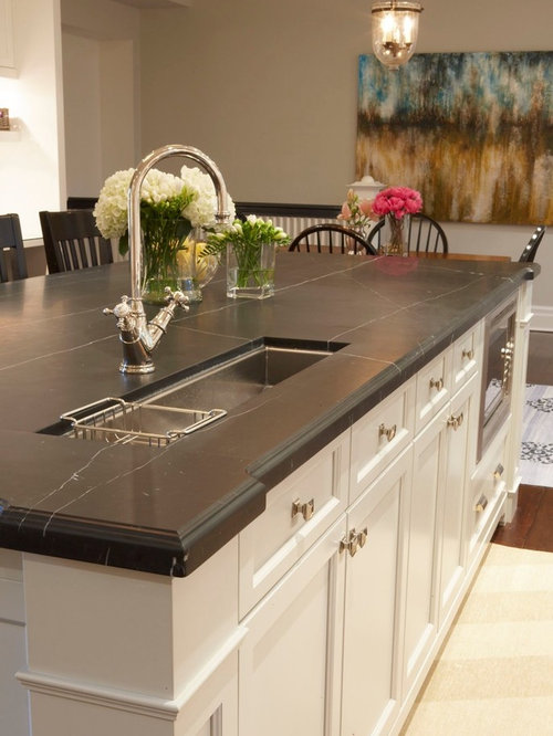 Elegant eat-in kitchen photo in Toronto with an undermount sink,  recessed-panel