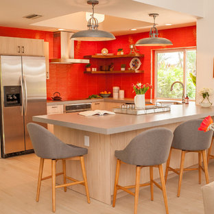 Design ideas for a mid-sized contemporary open plan kitchen in Miami with an undermount sink, shaker cabinets, light wood cabinets, quartz benchtops, orange splashback, glass tile splashback, stainless steel appliances, porcelain floors, with island, beige floor and white benchtop.