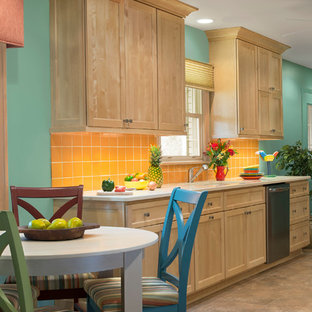 Large tropical galley eat-in kitchen in Milwaukee with an undermount sink, shaker cabinets, light wood cabinets, quartz benchtops, yellow splashback, terra-cotta splashback, stainless steel appliances, vinyl floors and no island.