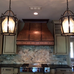 Tucker hood *Featured in an add by Durham Designs & Consulting, LLC in the Charl - Burnished hand hammered copper oven hood with copper straps, custom molding and dads.