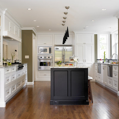 Inspiration for a transitional u-shaped kitchen remodel in Vancouver with recessed-panel cabinets, white cabinets and stainless steel appliances