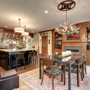Inspiration for a craftsman open concept kitchen remodel in Minneapolis with shaker cabinets, medium tone wood cabinets, beige backsplash and stainless steel appliances