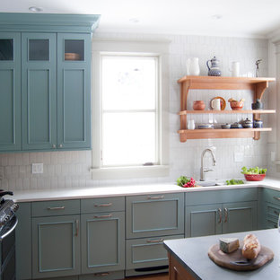 Mid-sized farmhouse enclosed kitchen appliance - Mid-sized country l-shaped cork floor and brown floor enclosed kitchen photo in Chicago with an undermount sink, recessed-panel cabinets, green cabinets, quartz countertops, gray backsplash, porcelain backsplash, stainless steel appliances and a peninsula