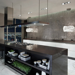 Inspiration for a large contemporary galley open plan kitchen in Las Vegas with a double-bowl sink, flat-panel cabinets, white cabinets, metallic splashback, mosaic tile splashback, marble floors, laminate benchtops, stainless steel appliances and a peninsula.