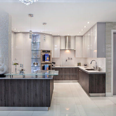 Huge minimalist l-shaped marble floor eat-in kitchen photo in Miami with a double-bowl sink, flat-panel cabinets, white cabinets, quartz countertops, white backsplash, mosaic tile backsplash, stainless steel appliances and an island