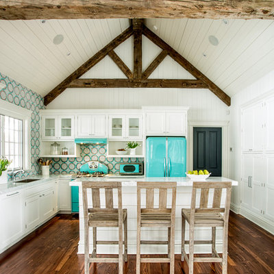 Example of a small country l-shaped medium tone wood floor open concept kitchen design in St Louis with white cabinets, colored appliances, an island, an undermount sink, beaded inset cabinets, quartz countertops, multicolored backsplash and mosaic tile backsplash