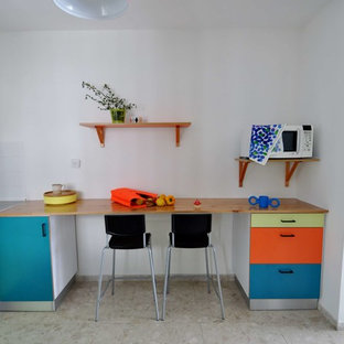 Mid-sized scandinavian l-shaped separate kitchen in Other with an undermount sink, turquoise cabinets, wood benchtops, white splashback, ceramic splashback, white appliances, marble floors, no island and multi-coloured floor.