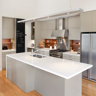 Photo of a mid-sized contemporary l-shaped eat-in kitchen in Sydney with a double-bowl sink, flat-panel cabinets, beige cabinets, brown splashback, stainless steel appliances, quartz benchtops, medium hardwood floors, timber splashback and with island.