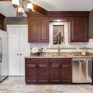 Small mediterranean kitchen pantry photos - Inspiration for a small mediterranean u-shaped ceramic tile kitchen pantry remodel in DC Metro with an undermount sink, raised-panel cabinets, dark wood cabinets, granite countertops, multicolored backsplash, mosaic tile backsplash and stainless steel appliances