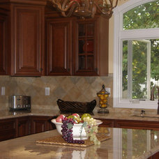Traditional Kitchen by Laura Callias