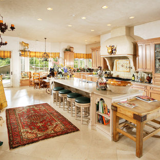 Large mediterranean open concept kitchen designs - Large tuscan galley open concept kitchen photo in Sacramento with beaded inset cabinets, light wood cabinets, beige backsplash, stone tile backsplash, an island, granite countertops, stainless steel appliances and a farmhouse sink