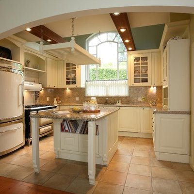 Tuscan u-shaped kitchen photo in Vancouver with glass-front cabinets, white cabinets, brown backsplash and white appliances