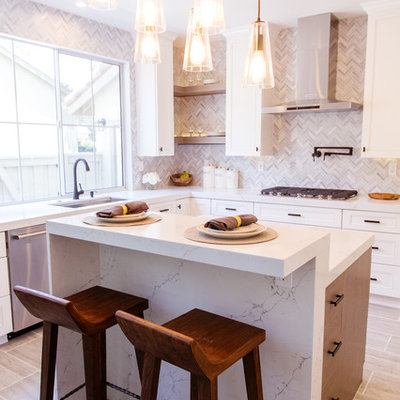 Inspiration for a mid-sized contemporary l-shaped gray floor and porcelain tile eat-in kitchen remodel in Orange County with an undermount sink, shaker cabinets, white cabinets, gray backsplash, mosaic tile backsplash, stainless steel appliances, an island and marble countertops