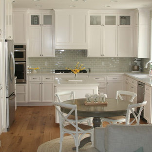 Transitional kitchen ideas - Kitchen - transitional medium tone wood floor kitchen idea in Other with an undermount sink, recessed-panel cabinets, white cabinets, quartz countertops, blue backsplash, subway tile backsplash, stainless steel appliances and an island