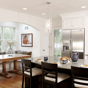 Inspiration for a large traditional eat-in kitchen in Chicago with shaker cabinets, white cabinets, stainless steel appliances, granite benchtops, with island and medium hardwood floors.