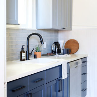 Small contemporary eat-in kitchen photos - Example of a small trendy single-wall ceramic floor and gray floor eat-in kitchen design in San Francisco with an undermount sink, shaker cabinets, blue cabinets, quartz countertops, gray backsplash, ceramic backsplash, stainless steel appliances, no island and white countertops